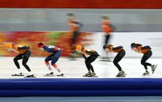 Netherlands speed skating team members and an unidentified skater from France (2nd L) practice at the Adler Arena, February 4, 2014.