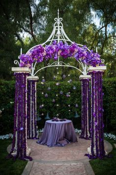 Purple Wedding Decor - purple flowered arch