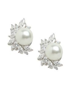 We love the way these earrings take the traditional pearl motif and up the luxurious ante. The point of difference? That exquisite bed of sparkling marquise crystals.