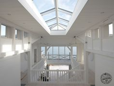 Light and airy entrance hall on the coast. By Carpenter Oak
