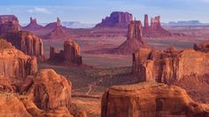 Monument Valley at the Arizona-Utah Border. Located on the Arizona-Utah border near the Four Corners region lies sandstone buttes on an iconic stretch of land in the Navajo Indian Nation. Arizona Road Trip, Arizona Travel, Visit Arizona, Arizona Usa, Arizona State, Sedona Arizona, Arches Nationalpark, Yellowstone Nationalpark, Beautiful Places To Visit