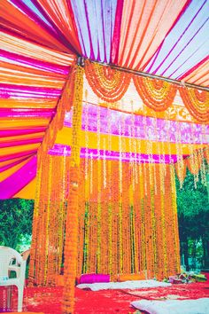 Purple and orange mandap , genda flower strings, indian wedding decor , mandap