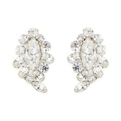 This is a pair of Swarovski clear crystal #vintage clip on #earrings by designer Sherman.  The #bridalearrings are made from faceted round and oval crystals which surround a large feature marquise cut crystal.  The earrings are set on silver plate and have brilliant sparkle. €119 Available from www.luluandbelle.com #vintagejewellery