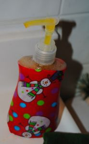 Simple Snowman Craft: Holiday Fabric Decoupage Soap Dispenser made with Mod Podge.