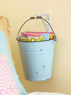 Hanging Storage  Keep magazines, books, and more close at hand by stashing them in an old bucket. Clean out the bucket, polish it off with a fresh coat of paint, and hang it from a plant hook by the bedside, in a cozy reading corner, or in the bathroom.  Lexie this would be cute by the stove in the kitchen for your utensils - easy to get to and not on the counter!