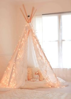 Pin for Later: Girls' Night In: How to Throw a Grown-Up Sleepover Indoor Tent Make or buy a pretty teepee tent for dreamy sleeping. Teepee Tent, Teepees, Forts, Tent Poles, Baby Teepee, Girls Teepee, My New Room, My Room, Indoor Tents
