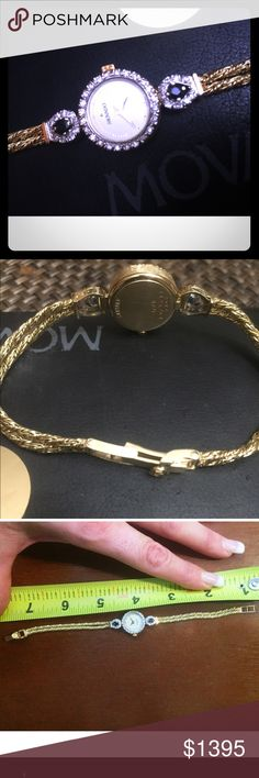 Beautiful antique sold gold diamond sapphire watch One of a kind.. In mint condition! Gold diamond and sapphire watch.. In perfect working condition! This will add Perfect touch of class and uniqueness to any outfit. Movado Accessories Watches