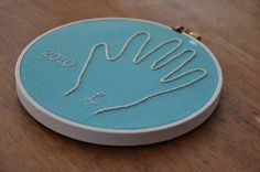 Custom Child's Embroidered Handprint Hoop Art - $19.95, via Etsy.  (or diy - would be a cute gift for grandparents)