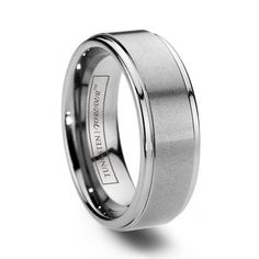 Tungsten-carbide wedding band for the groom: manly, tough, can be engraved, AND affordable!