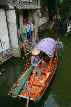 Rowing a little boat on ZhouZhuang channels - Shanghai, China