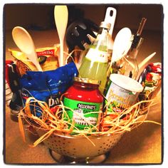 Auction basket: filled a colander with 2 bags of pasta (plain and . Theme Baskets, Themed Gift Baskets, Raffle Baskets, Chinese Auction, Silent Auction Baskets, Olive Oil Dispenser, Gift Baskets For Men, Auction Items, Food Crafts