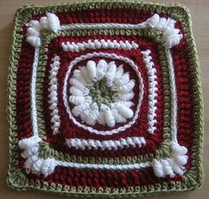 Ravelry: Homecoming Queen of Bullions pattern by Margaret MacInnis  This would make a great hotpad with those bullion stitches.
