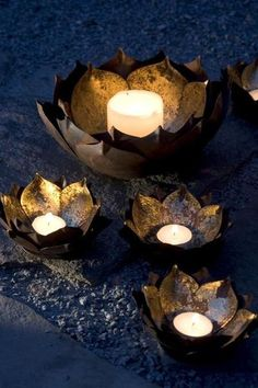 "These metal Lotus Flower Candle bowls have a gold leaf center to reflect the light. small 5"" diameter x 2.25""H large 10"" diameter x 3""H gold finished metal not"