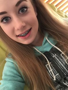 Chubby blonde teen with braces