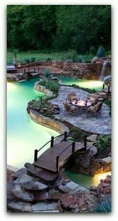 A bridge to a patio island in the middle of the pool. Love this idea
