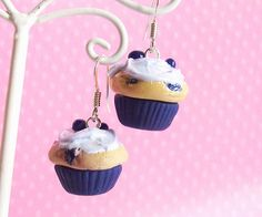 OK they don't sparkle, but what little girl wouldn't want mini-cupcakes dangling from her ears. What an amazing idea for Christmas!  Blueberry Cupcake Earrings Kawaii Fake Polymer by FrostedSoSweet, $15.00