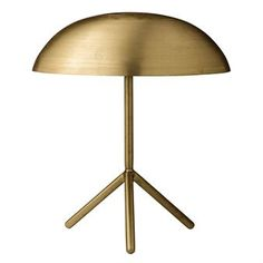 This elegant table lamp from Bloomingville has a contemporary design with a subdued shade and three legs. The lamp becomes a decorative detail on a side table or on your desk and it also provides you with a cozy light. Match with other lamps or interior decorations from the Danish brand Bloomingville.