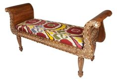 Handcrafted wooden bench with camel-bone inlay upholstered in handmade ikat fabric from Uzbekistan.