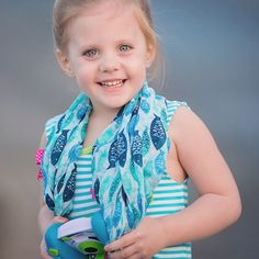 Lil Paisley is fishy fabulous in her Kiddie Camera Scarf with her Vtech camera...Such a cutie!@thecamerascarf ❤️WWW.thecamerascarf.com ❤️ Photo cred  @kellyparnellphotog ❤️#thecamerascarf #camerascarf