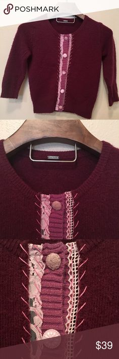 Free People cardigan sweater Adorable cardigan by Free People. In great condition with only minor signs of wear. No stains, holes, etc. Pretty cranberry wine color with pink lace down the front, and different pink buttons. So cute and unique. Dark pink thread is woven in and out for a beautiful touch. Wool blend. Hand wash. Free People Sweaters Cardigans
