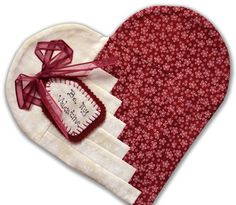 Heart Mug Rug. The pattern, from Penny Haren (author of Log Cabin Quilts), is a free PDF download.