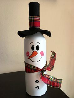 Hand Painted Snowman on a wine bottle decorated with burlap hat and scarf. Give bottle crafts with burlap Hand Painted Snowman on a wine bottle decorated with burlap hat and scarf. Wine Glass Crafts, Wine Bottle Crafts, Mason Jar Crafts, Painted Wine Bottles, Lighted Wine Bottles, Decorated Wine Bottles, Snowman Crafts, Holiday Crafts, Christmas Wine Bottles