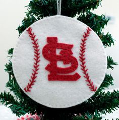 This is a handmade wool blend felt hanging Christmas ornament. It is inspired by the St. Louis Cardinals.