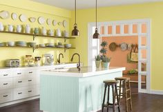 Yellow and soft green kitchen.