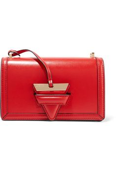 """""""When it comes to accessories, you should consider red the new neutral,"""" recommends PORTER. Expertly handcrafted from smooth leather, Loewe's 'Barcelona' bag boasts just enough space for your cell phone, cosmetics and keys and it has a distinctive triangular tab fastening - borrowed from the label's archives. Adjust the strap to carry yours cross-body."""