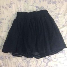 Hollister dark navy chiffon skirt Multiple layers. Super cute dark navy color like black color. Great condition. 11 shipped merca. Size XS but can fit small Hollister Skirts Mini