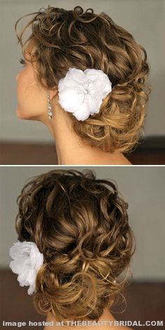 To get this soft upsweep, stylist advises misting hair with a few spritzes of water until damp, then working in a styling mousse and blow-drying on a low setting, scrunching in waves with fingers as you go. Next, roll and pin hair into a loose bun and accent with fresh plumeria blossoms. Key to success: using a curling iron after blow-drying to ensure extra wave in the front sections of hair.