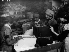 As part of the war effort, old paper had to be reused. These women are pulling apart old ledgers belonging to the London & South West Railway. vintage everyday: 16 Incredible Photos Show Daily Life of British Women War Workers during World War One