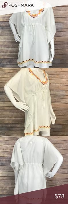 """Trina Turk Caftan style Swimsuit Cover up •Details• This is gorgeous!  Embroidered and sequined trim. Tie at waist. Loose, breezy fit •Condition• NWT •Material• 70% cotton, 30% silk •Color•white with yellow, orange, pink, and purple design  All measurements are taken while item is laying flat and are approximate.  •Armpit to Armpit•open so no measurement •Length•32"""" •Waist•21.5"""" all the way loose  I consider ALL Offers! Don't be shy! No Trades Trina Turk Swim Coverups"""