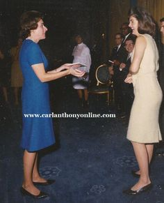 Oct 1963- chatting with Nancy Tuckerman at Nancy's birthday party.