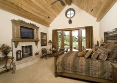 This is a nice size master bedroom.  I just am unsure about the t.v. over the fireplace.