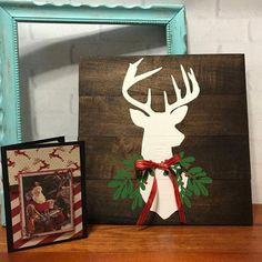 Warm up this Holiday Season with this simply beautiful rustic Decor piece. A deer head silhouette that has a touch of Christmas garland around his neck. To top it off with a handmade Christmas bow. Pallet Christmas, Christmas Bows, Christmas Signs, Country Christmas, Christmas Projects, Christmas Ornaments, Cabin Christmas, Wooden Christmas Decorations, Reindeer Decorations