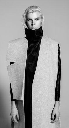 Abigail Lewis - Sliced Lapel Sleeveless Coat in heather gray wool felt, Turtle Neck-lining Dress in caviar.