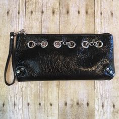 "Just InBlack Textured Patent Faux Leather 10"" X 4 1/2"" with a removable wrist band. Never been carried. Non smoking home Bags Clutches & Wristlets"