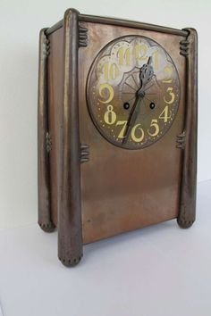 Beautiful Amsterdam School copper mantle clock, 1920's Art Deco | From a unique collection of antique and modern clocks at https://www.1stdibs.com/furniture/decorative-objects/clocks/