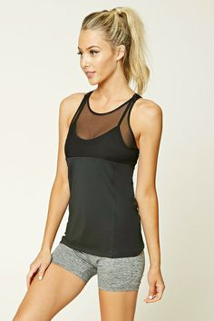 A knit athletic top featuring a mesh front, illusion neckline, a built-in sports bra with removable cups, crisscross straps, and moisture management.