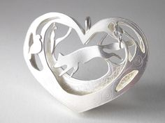 Sterling silver woodland scene pendant of fox and birds £180.00