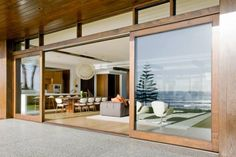 http://taizh.com/wp-content/uploads/2014/11/Nice-wide-sliding-glass-door-design-with-fancy-chandelier-above-dining-table-set-also-living-space-in-the-nearby-along-with-laminate-wooden-floor.jpg
