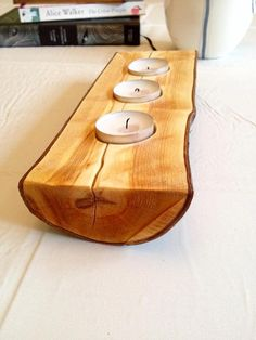 A beautiful tealight candle holder made out of genuine cherry wood. The surface has been cleaned, sanded smooth and oiled to bring out the natural grain of the wood and shine of the dark red bark. This item has a real rustic feel and can be placed as a centrepiece or as a collection with other home decor items. Ethically sourced; I have a tree surgeon friend who had to cut some of a cherry tree off, and he kindly gave me the best piece! L25 x W9.5 x H4cm