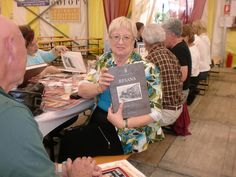 Sarasota Sister Cities member Peggy Abt with Resana, Italy history book presented to the visiting delegation at the annual Polenta Fest in September 2010
