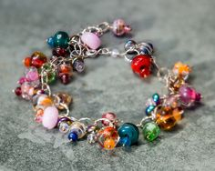 Happy Charms Lampwork Bead and Gem Charm Bracelet by JoBellaBijoux, $130.00