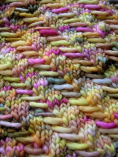 Woven diagonal herringbone knit stitch - nice stitch for showing of variegated yarn.