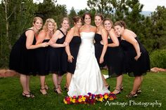 Putting the flowers in front of the bride and bridesmaids.