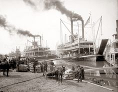 Loading the Delta Queen Riverboat in the early 1900s on the Mississippi River in New Orleans.
