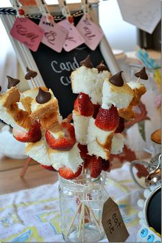 Strawberry Shortcake skewers. Angelfood cake and strawberries with a Hershey kiss on top.
