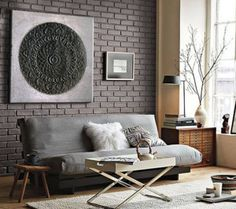 http://mulberryinteriordesign.ca/wp-content/uploads/condo-loft-style-living-room-with-tall-windows-and-charcoal-grey-brick-accent-wall-300x266.png